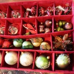 Customizable trays makes storing different size ornaments a breeze